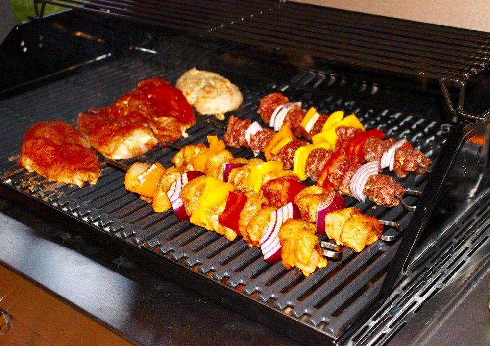 Chicken and kebabs roasting