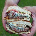 sliced in half bleu cheese bacon burger