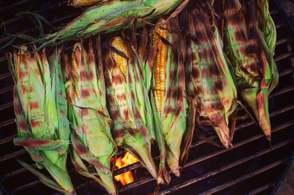 open fire cooking corn