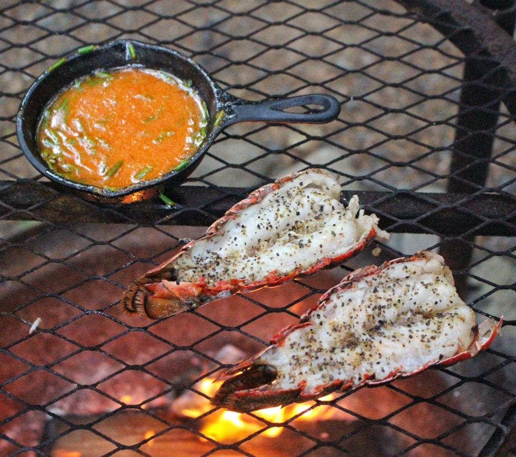sriracha butter lobster tails over the fire