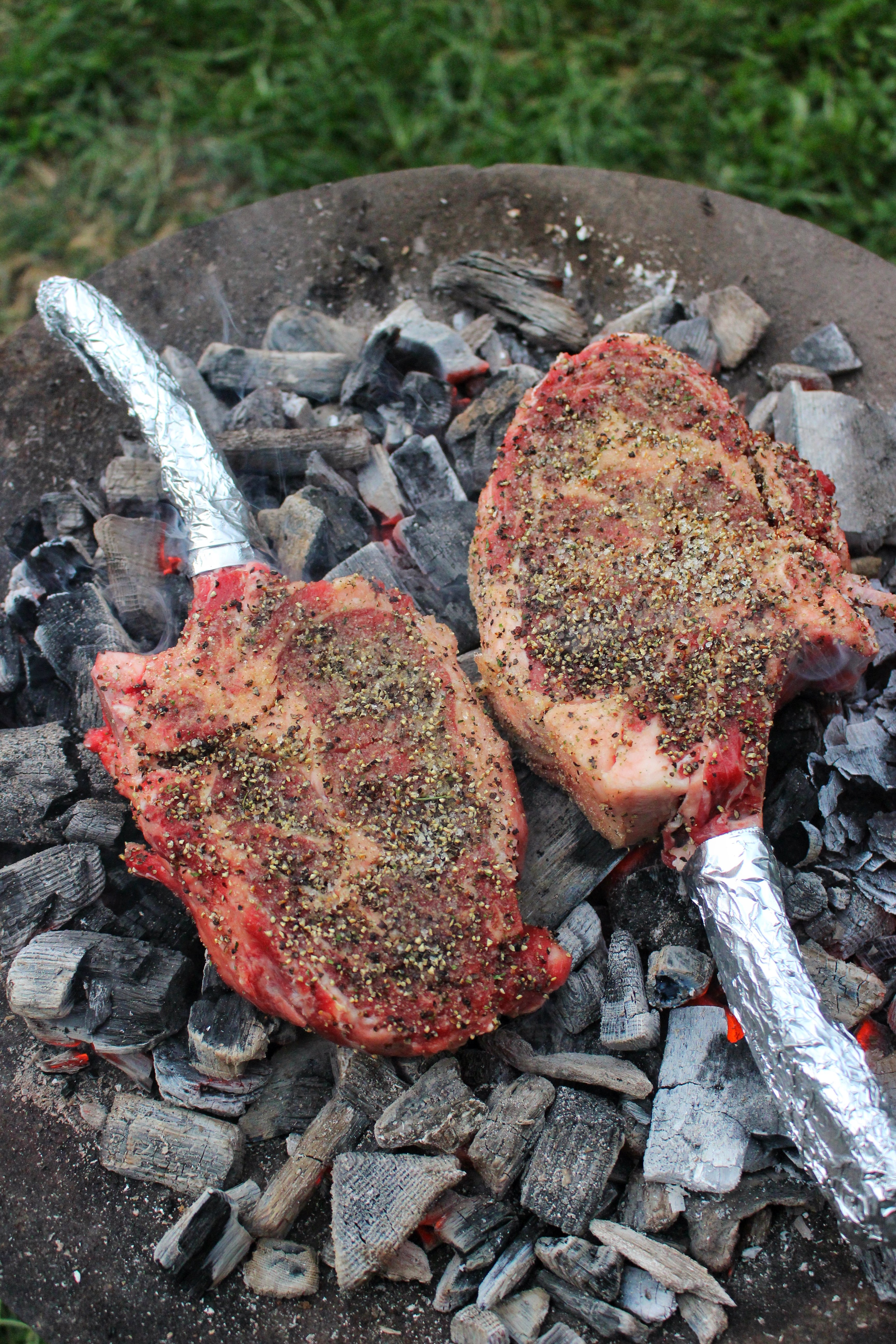 Dirty Tomahawk Steaks with Steakhouse Butter
