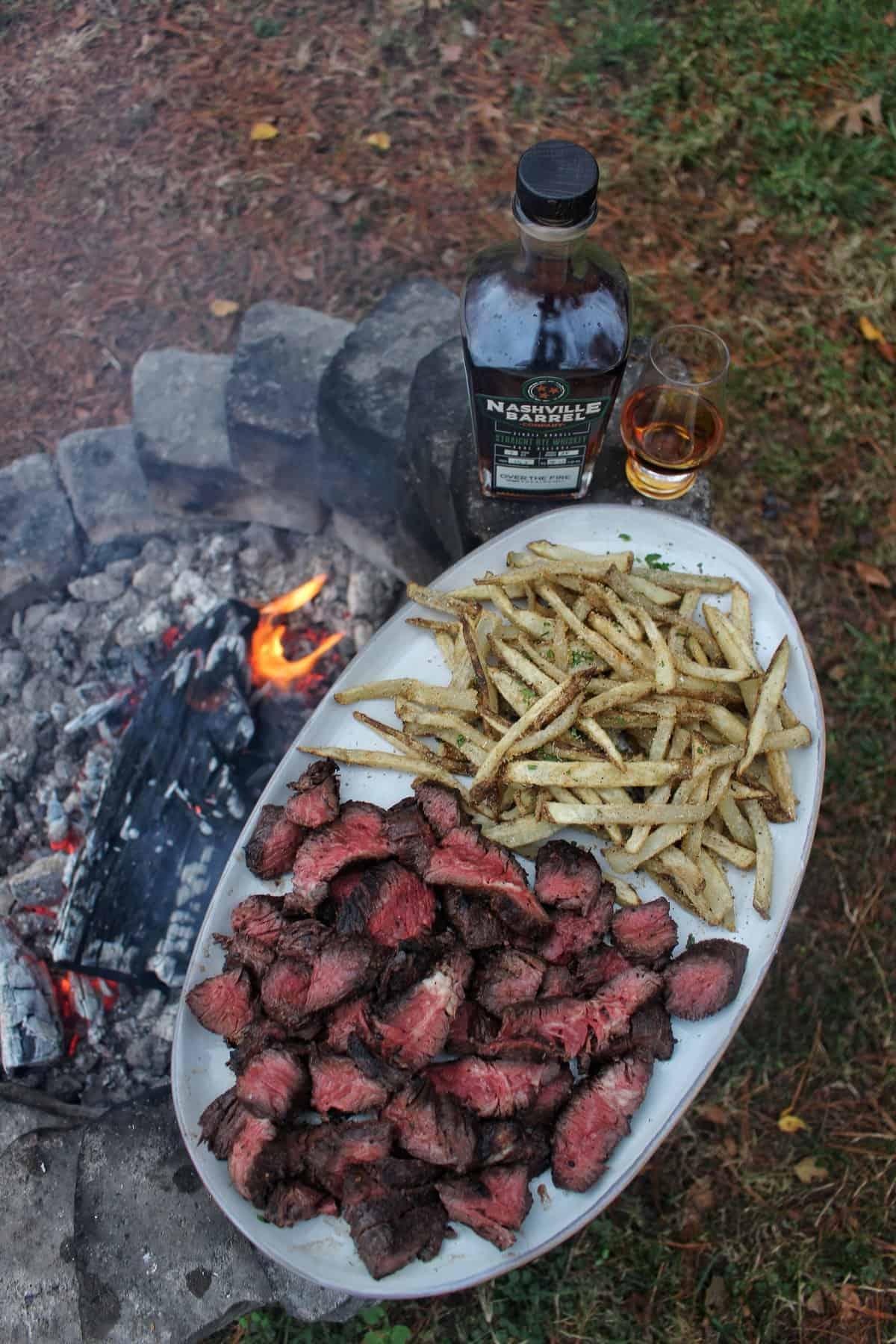 umami whiskey marinated hanger steaks