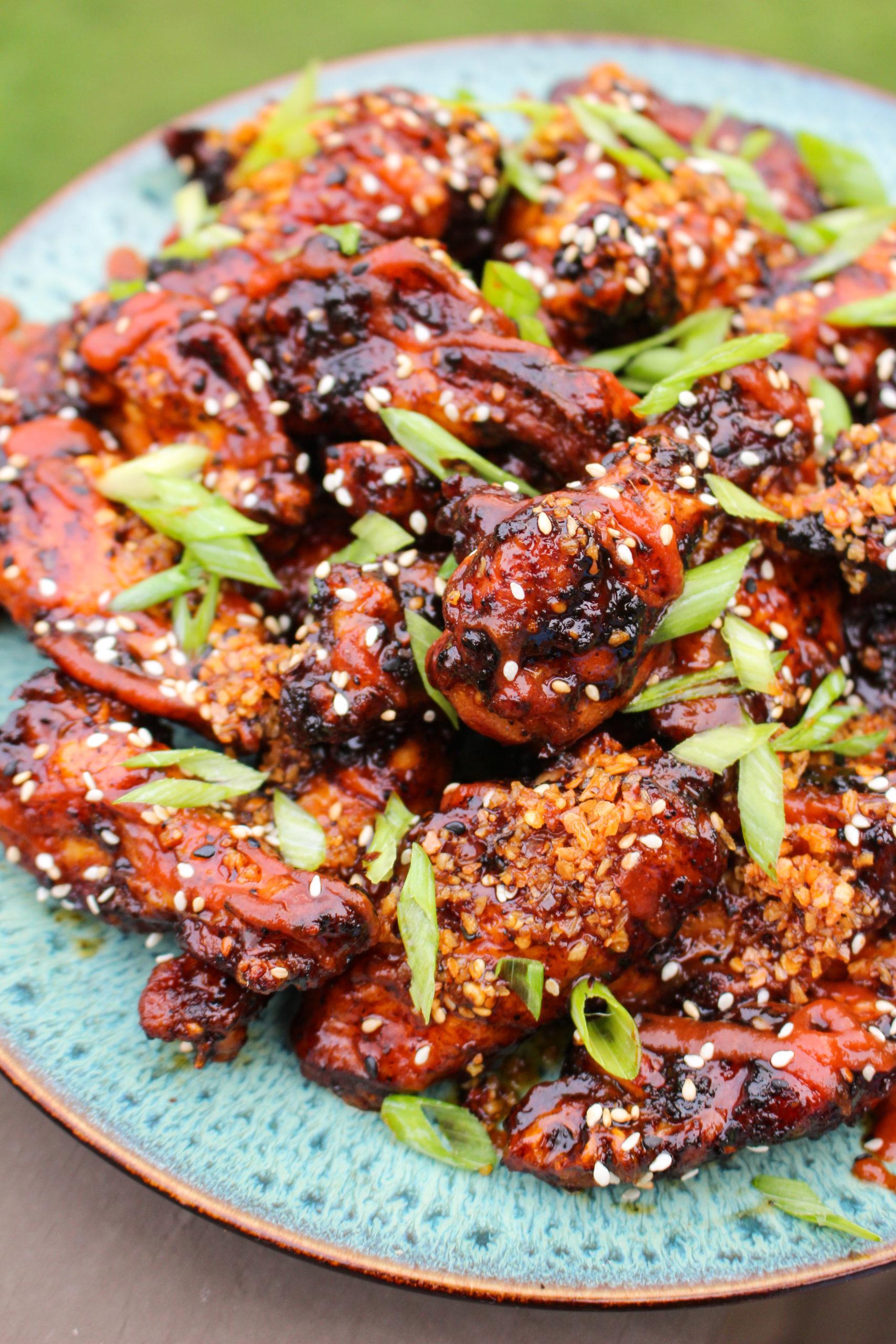 Honey Gochujang BBQ Wings get garnished