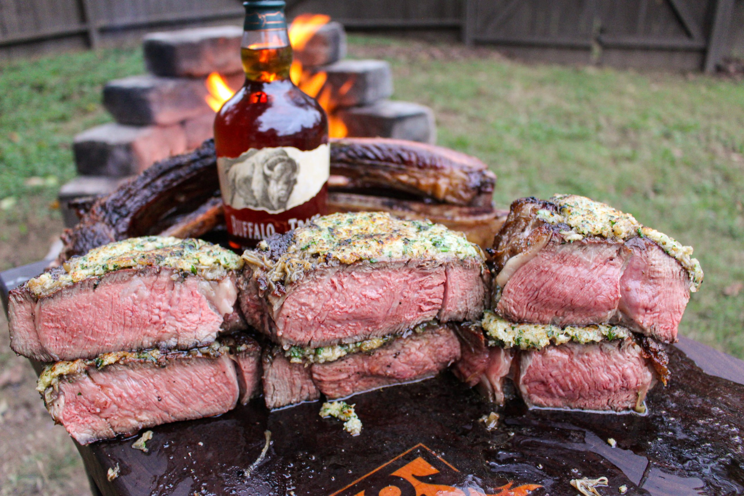 Tomahawk Steaks with French Onion Crust sliced and ready to eat.